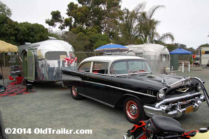 This vintage towing rig is a 1957 chevy bel air 2 door sedan pulling a vintage clipper trailer