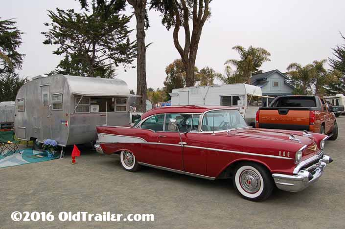 This vintage towing rig is a 1957 chevy bel air 2 door coupe pulling a vintage boles aero trailer