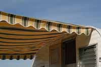 Loads of photos of striped canvas awnings and canopies on vintage travel trailers