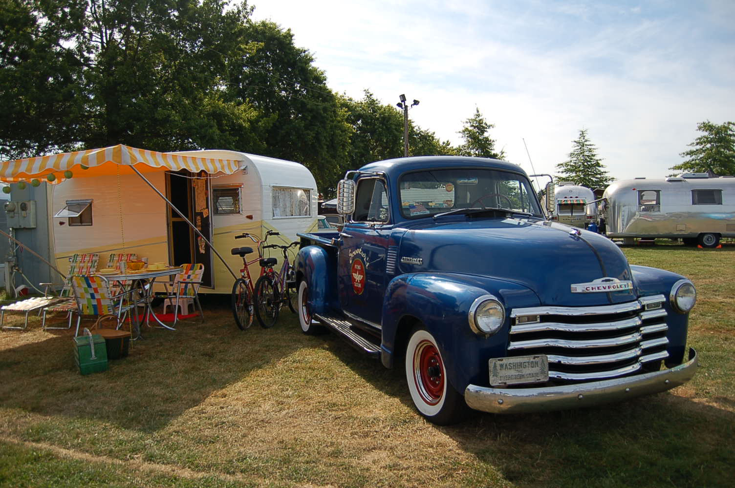 Classic 1958 Aloha Trailer Next To Vintage Chevy Pickup Truck Tow Vehicle
