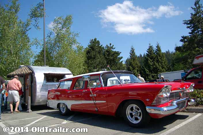 This vintage towing rig is a 1958 Plymouth Surburban Wagon pulling a Vintage Airfloat Trailer