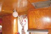 Photo shows beautiful golden ash finish on cabinets in 1958 Shasta 1500 Trailer