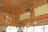 Re-finished ash cabinets and paneling in 1959 Shasta Airflyte Trailer