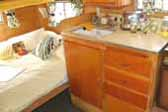 Photo of restored kitchen counter and cabinets in 1959 Shasta Airflyte Trailer