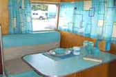 Fun kitchen retro design theme in 1959 Shasta Airflyte vintage trailer