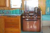 Photo shows vintage blue kitchen accessories in 1959 Shasta Airflyte Trailer