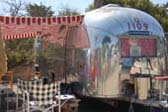 1960 Airstream Tradewind Trailer With Red Striped Side Canopy