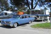 Vintage 1960 Holiday House trailer and vintage 1959 Pontiac Bonneville Safari station wagon tow vehicle