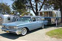 View vintage cars, trucks and station wagons pulling and towing vintage trailers