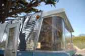Picture of ribbed siding and curved glass on front of vintage 1960 Holiday House trailer
