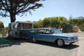 Photo of 1959 Pontiac Bonneville Safari station wagon towing 1960 vintage Holiday House trailer