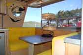 Dining area in front of 1960 vintage Holiday House trailer