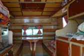 Spectacular nautical inspired interior woodwork on a unique camper on th ebaqck of a 1960 International Pickup Truck