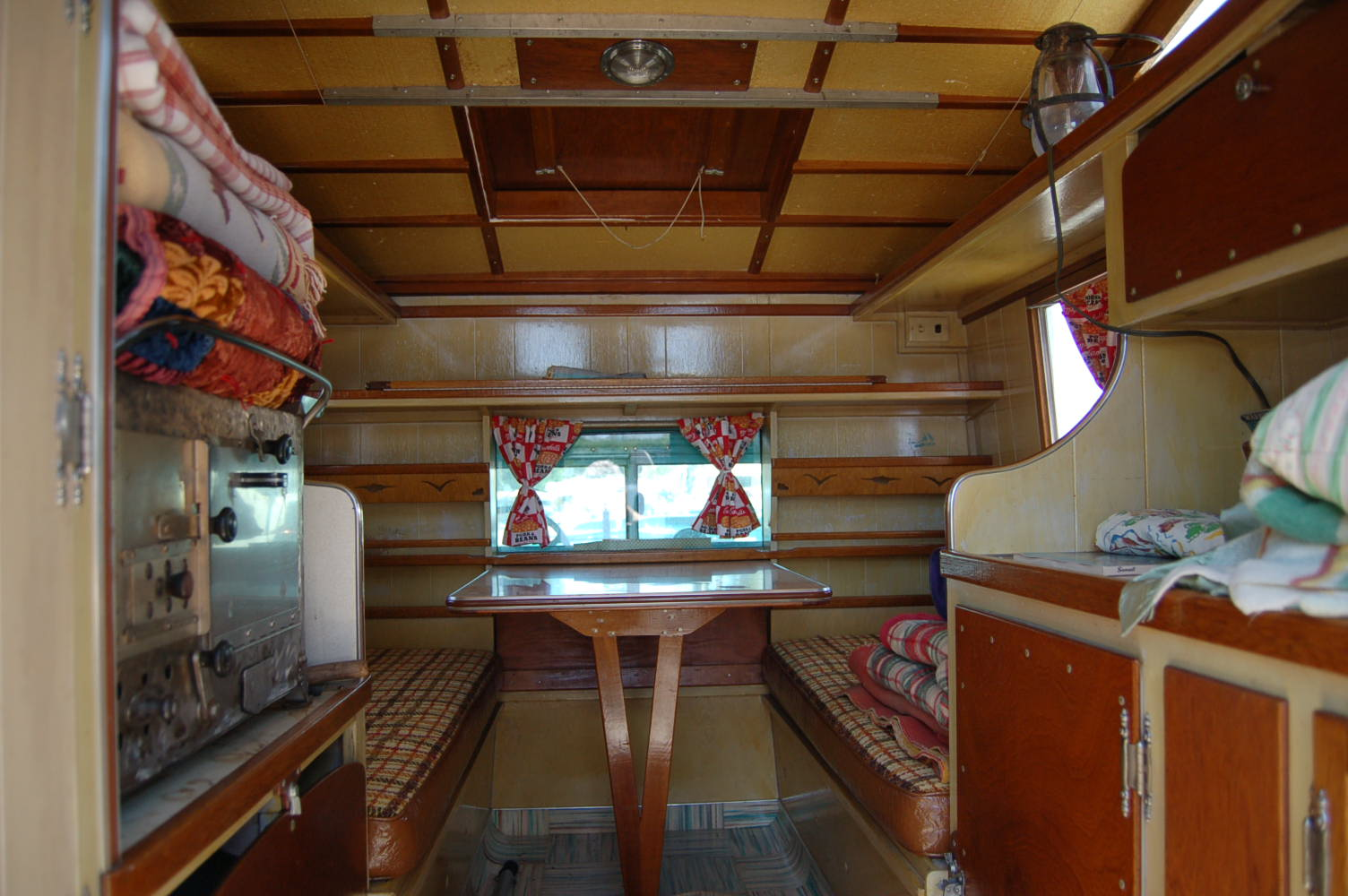 Spectacular nautical inspired interior woodwork on a unique camper on th ebaqck of a 1960 international