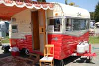 Picture of a restored 1960 Shasta trailer showing the new front profile introduced in model year 1958