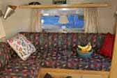 Living room & sleeping area in immaculate 1961 Airstream Bambi travel trailer