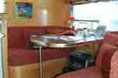 1961 Airstream Globetrotter Trailer With Glowing Wooden Walls and Cabinet work