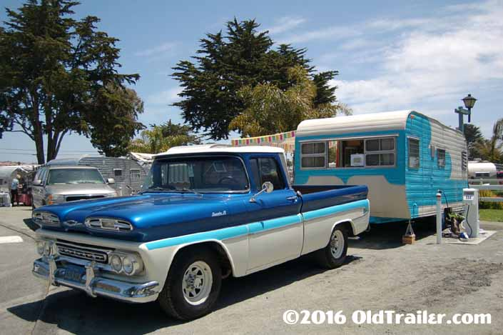 This vintage towing rig is a 1961 chevy apache pickup truck pulling a 1958 roadliner travel trailer