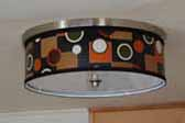 Picture of a great mid-century retro drum-styled ceiling light fixture installed in a 24ft. 1961 Holiday House vintage trailer with tandem axles