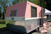 Great picture showing angular rearend of 1961 vintage Holiday House travel trailer