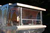 Picture of unique curved front corner windows in a 1961 Holiday House trailer dining area