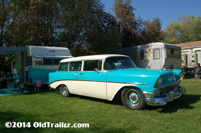 This vintage towing rig is a 1956 Chevy 210 2-door station wagon pulling a 1961 shasta 16sc travel trailer