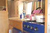 Very sharp navy blue stove and fridge in vintage 1961 Shasta Compact Trailer