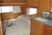 1961 Shasta vintage trailer with cozy bedroom and retro cowboy styled bedspread