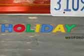 Photo of cool Holiday House graphic logo on rear end of 1962 Holiday 18-ft House trailer