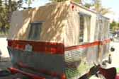 Photo of rear end of 1962 Holiday House 18ft. trailer