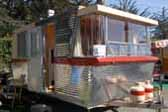 Photo of front view of a 1962 Holiday House Model-18 vintage trailer shows awesome Jetsons styling
