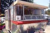 Photo of curved corner windows on front end of 1962 Holiday House Model 18 vintage trailer