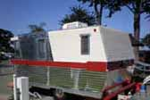 Side view picture of rare 1962 vintage Holiday House trailer
