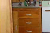 Photo shows original birch kitchen cabinets in 1962 Shasta Airflyte vintage trailer