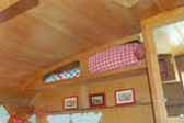 Refinished Wood Cabinets in 1962 Shasta Compact Trailer Dining Area