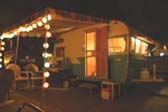 Vintage 1962 Shasta Trailer on party night, with lantern lights and awning