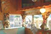 Photo of warm and inviting restored dining area in 1962 Shasta vintage trailer