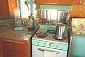Photo shows seafoam Princess gas stove and matching hood in 1962 Shasta Trailer