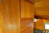 Honey gold cabinets and original cabinet hardware in 1962 Shasta Trailer