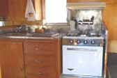 1962 Shasta Trailer with stainless steel back splash around sink and stove top