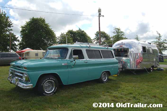 This vintage towing rig is a 1965 chevy suburban pulling a 1963 airstream travel trailer