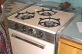 Original 3-burner gas stove unit in 1963 Shasta Travel Trailer