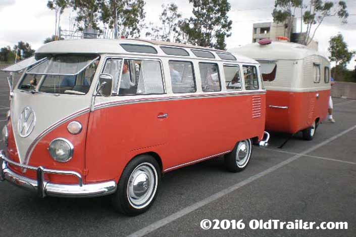 This vintage towing rig is a 1963 volkswagen 23-window samba bus pulling a vintage travel trailer