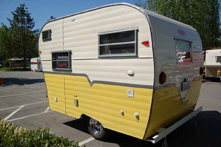 Great looking yellow and white vintage Aladdin Genie travel trailer