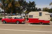 1964 Shasta Trailer being towed by a 1955 Chevy Nomad Station Wagon