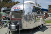 Highly Polished 1965 Airstream Caravel Trailer, Front View