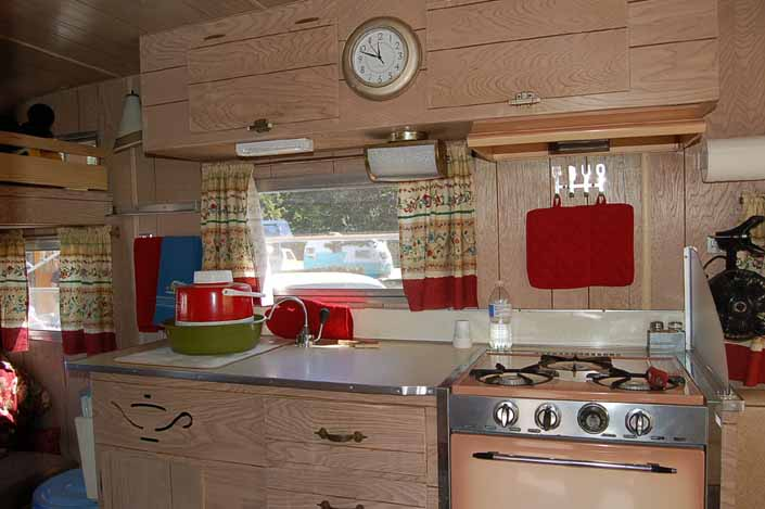 Original kitchen cabinets and woodwork in an Aladdin Magic Carpet Trailer