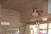 Photo shows the gas light fixture over the dining table in an Aladdin Magic Carpet model trailer