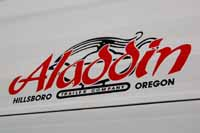 Photos of original and reproduction vintage trailer logos, decals, emblemsd and badges