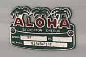 Photo of restored cast metal Aloha badge emblem on 1966 vintage Aloha travel trailer
